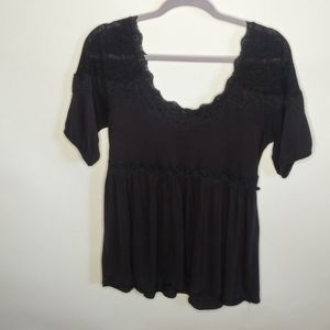 Free People short sleeve lacey shirt.